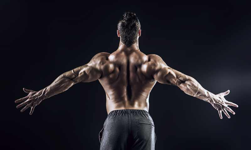 I see the guys in the magazines squatting some huge weights – doesn't heavy squatting damage the spine?