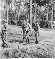 Accused : Arriving for his trial - CAPTAIN SUSIMI HOSHIJIMA (CENTRE), JAPANESE COMMANDANT OF THE PRISONER OF WAR CAMP AT SANDAKAN, BORNEO - convicted and hung
