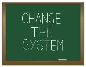 """A chalkboard has """"change the system"""" written on it. Weekly management systems are the best way to change dental front office systems."""