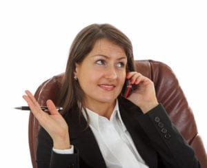 A businesswoman calls to reschedule her dental appointment.