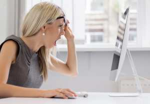 Mistakes in dental claims result in denials. A dental front office team member looks at her computer screen in shock at her error.