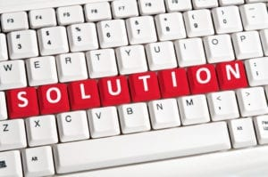 A computer keyboard spells out the word solution. A dental front office consultation could be the solution you need to solve a front office problem in your dental office.