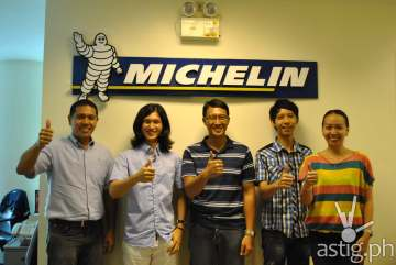 MICHELIN Philippines, composed of its Chief Representative Mike Nunag (L) and MarketingCommunications Manager Caroline Del Rosario (R), congratulate the winners of the MICHELIN Right2Race Game, namely Sung Joon Park, Ivan Isada and