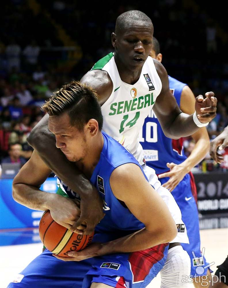 June Mar Fajardo guarding against Gorgui Dieng Gilas vs Senegal 2014 FIBA Basketball World Cup (FIBA.COM)