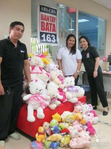 (L-R): A representative of Pandayan Bookshop with Mary Grace Siscar -- Bantay Bata 163's Resource Mobilization Officer and Ms. Caress Banson – Bantay Bata 163's Resource Mobilization Manager.