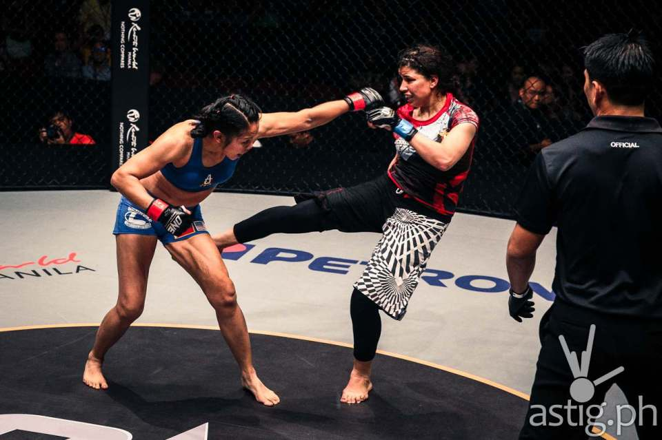 Ana Julaton delivers a left straight while Walaa Abbas connects with an outside right leg sweep