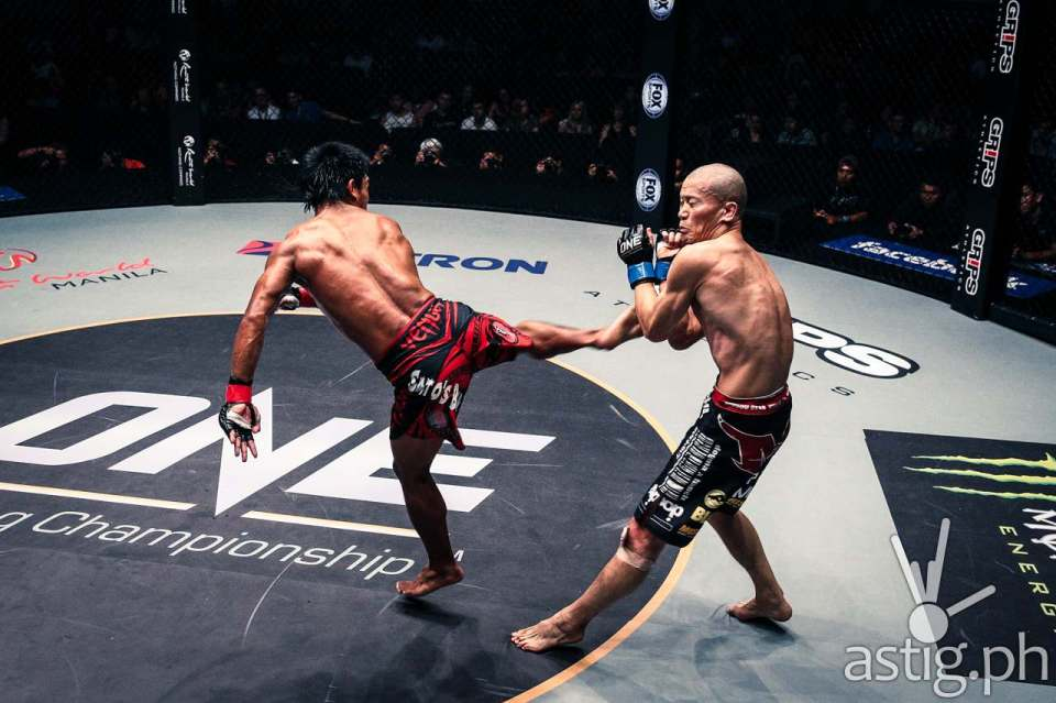 Kevin Belingon from the Philippines delivers a spinning back kick, winning via unanimous decision over Koetsu Okazaki from Japan