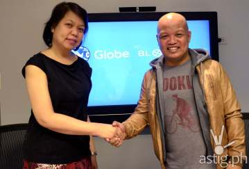 Yoly Crisanto, SVP for Corporate Communications at Globe Telecom and Abe Olandres, Nuffnang Philippines Country Manager for Blogopolis 2015