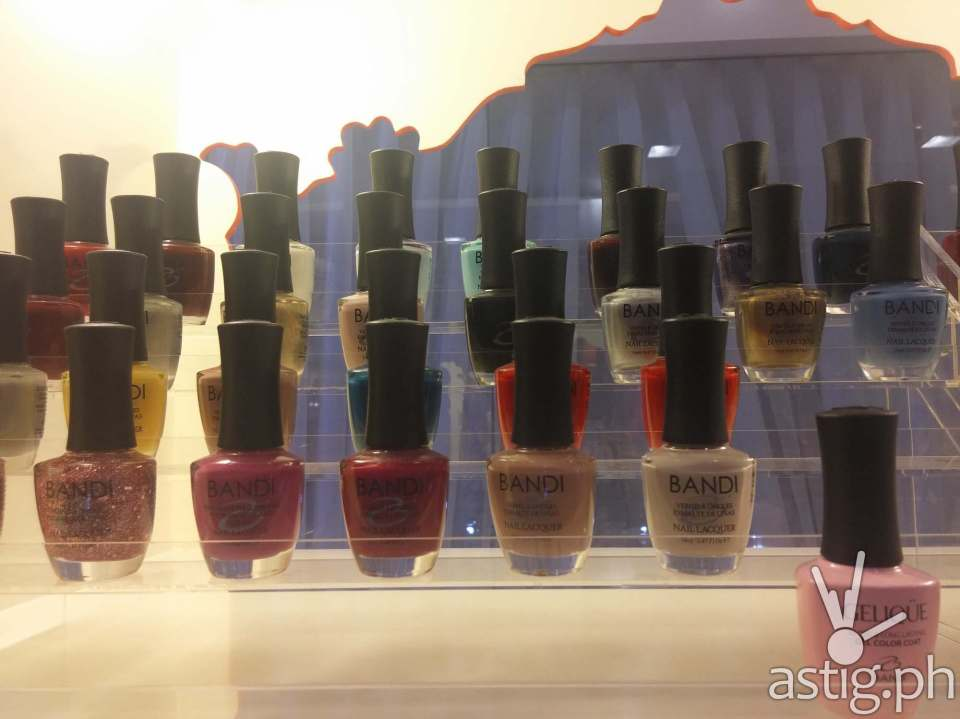 Bottles of Bandi and Gelique nail polish at Extraordinail