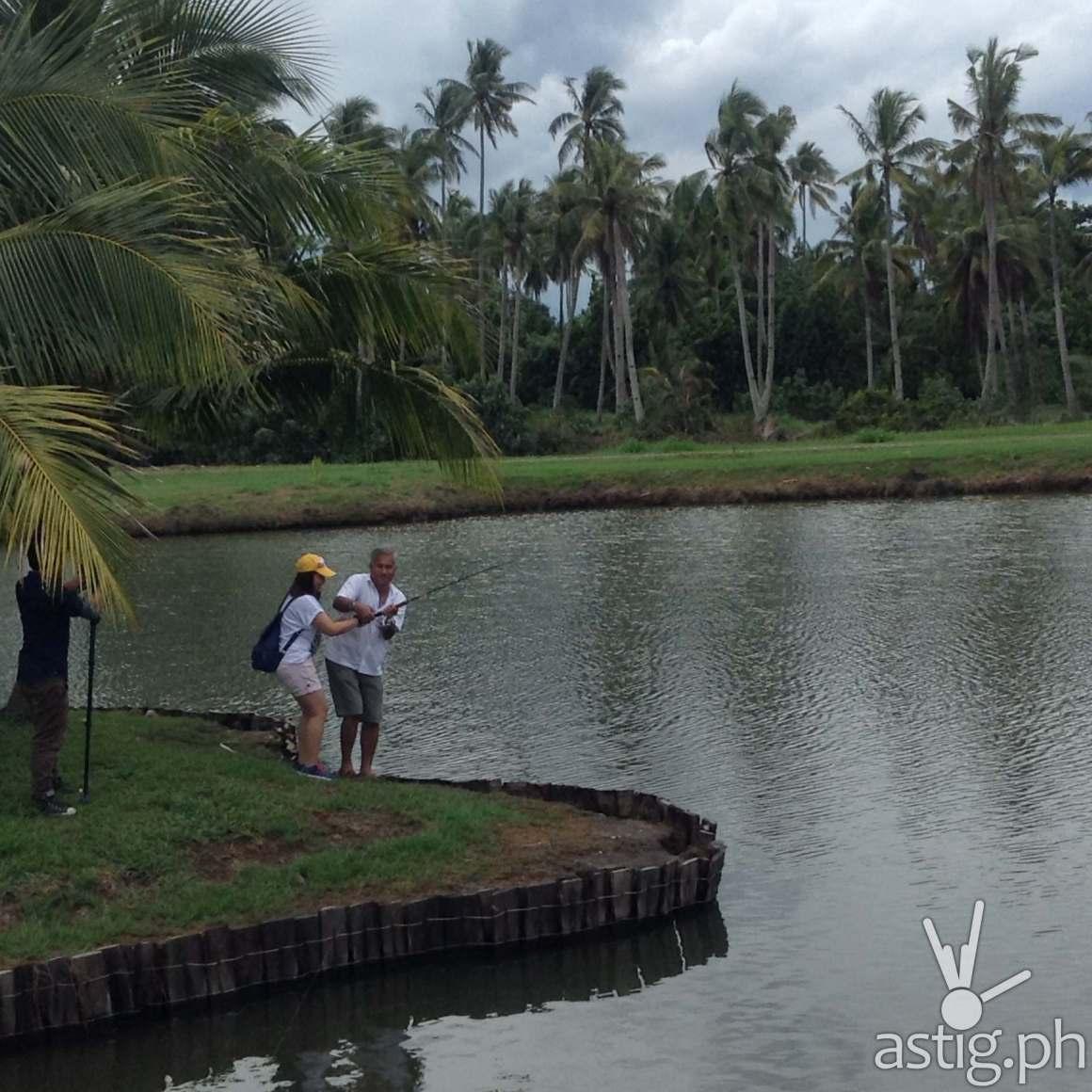 Guests try fishing at the fishing village at Banana Beach