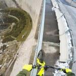 Biker Balances on Handrail Above 600ft Dam