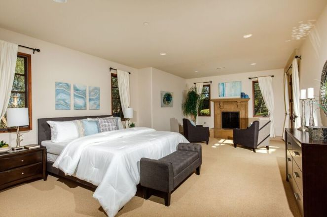 Bedroom staging with fireplace