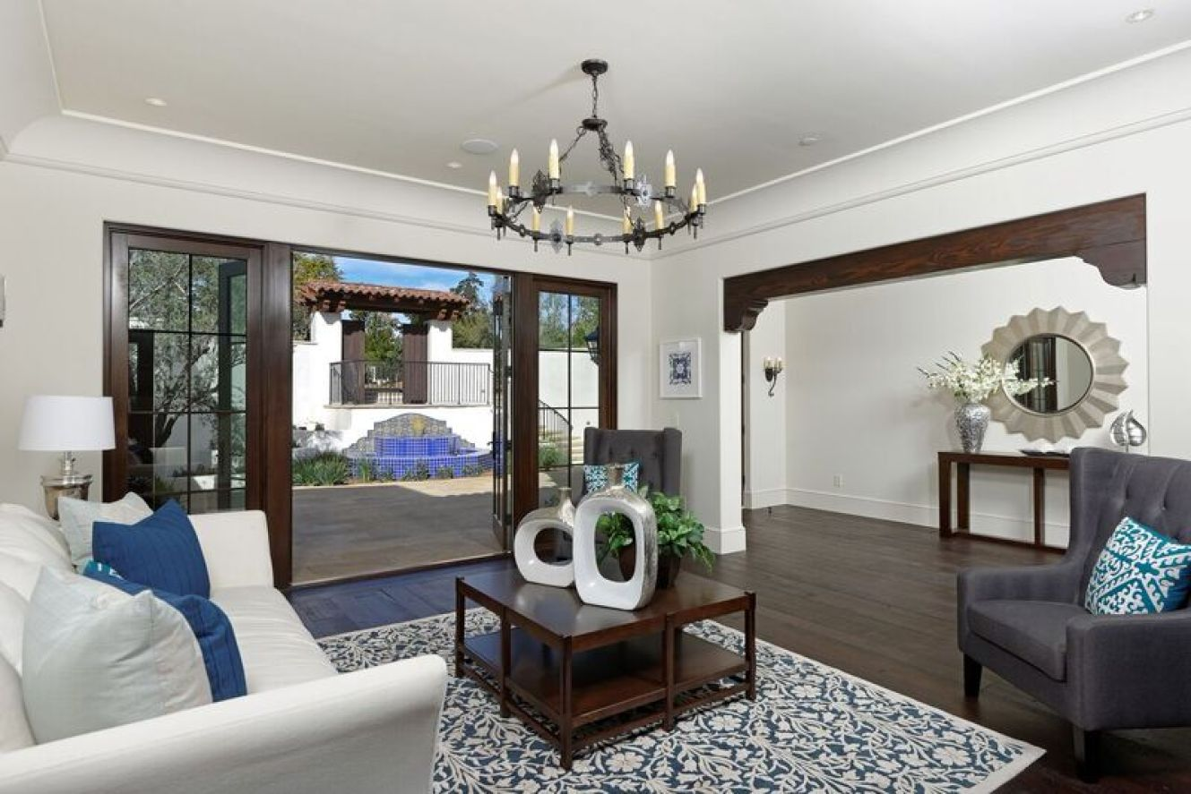 Living room staging with white and blue accents