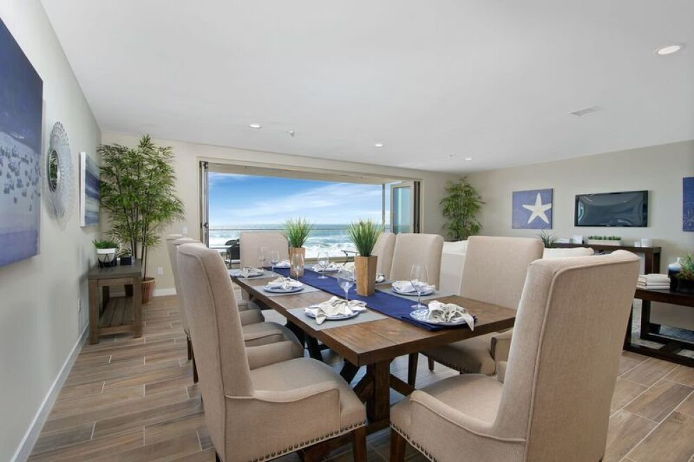 Dining room staging with white, beige and blue accents