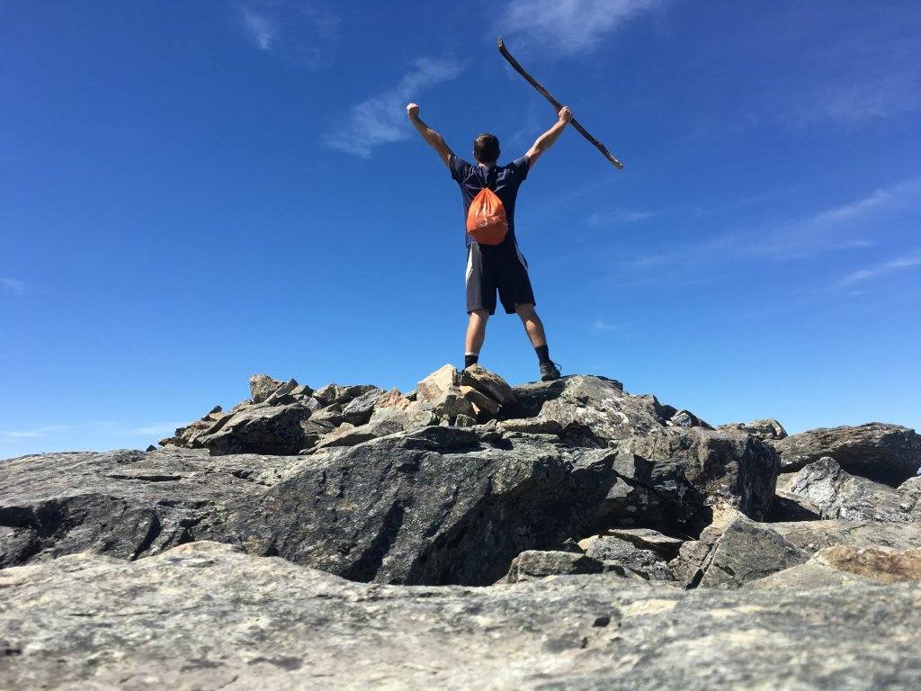 Enjoying the summit with the three-pound stick I carried to the top