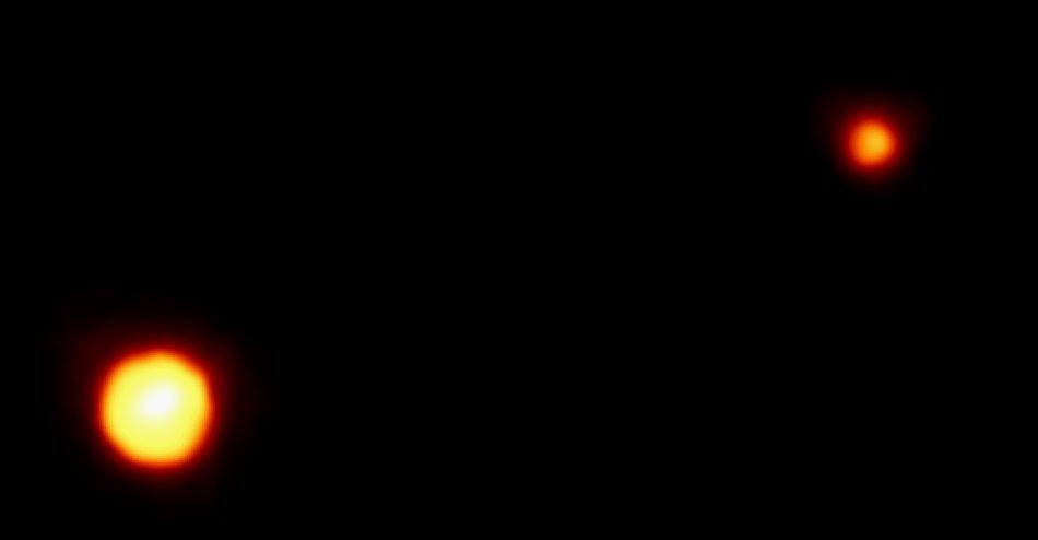Pluto & Charon do the perpendicular binary hip-hop