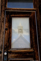 Old door and church reflection