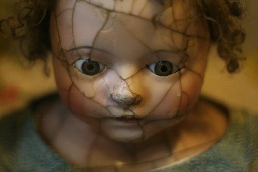 Chiron in 4th, 5th, 6th House: Close-up of the broken face of a doll