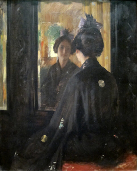 Saturn in Taurus: A woman sitting in a black kimono is looking at her own reflection in the mirror.