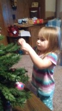 My daughter intently putting her decorations on