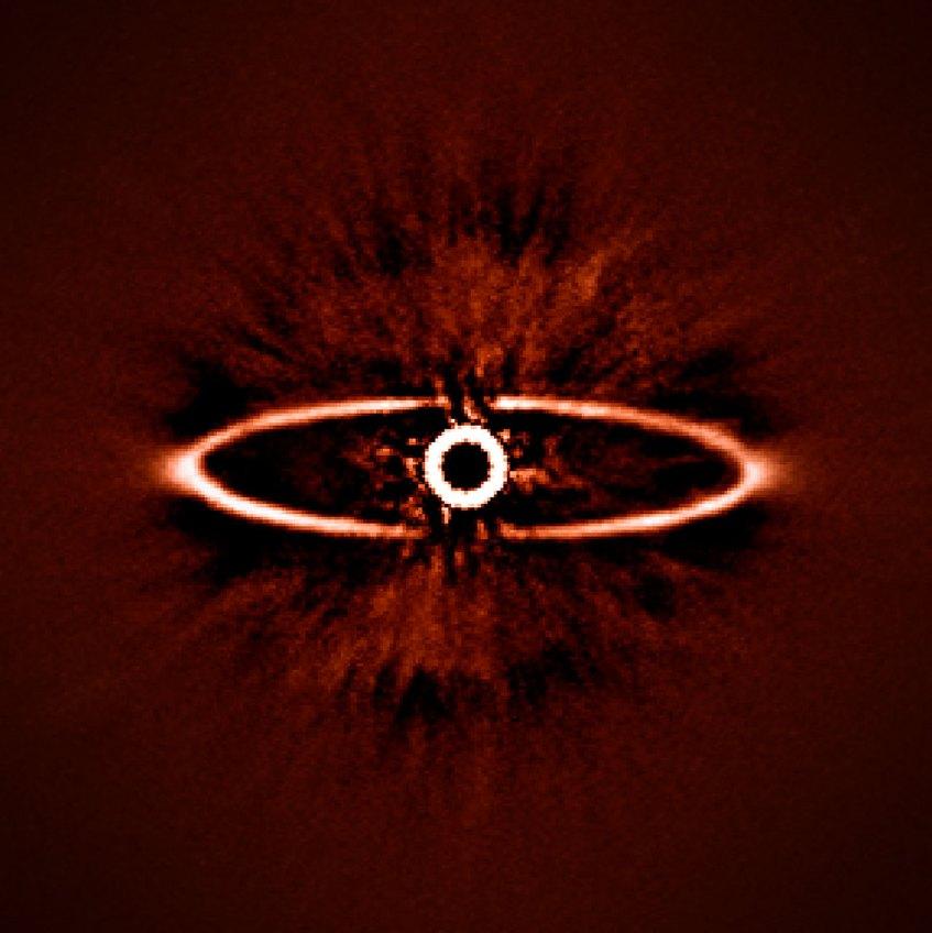 Esta imagem infravermelha mostra o anel de poeira em torno da estrela próxima HR 4796A, na constelação austral do Centauro. Trata-se de uma das primeiras imagens obtidas pelo instrumento SPHERE, pouco depois da sua instalação no Very Large Telescope do ESO em maio de 2014. A imagem mostra não apenas o anel com uma nitidez excecional mas ilustra também como o SPHERE consegue suprimir tão bem o brilho intenso da estrela - a chave para encontrar e estudar exoplanetas no futuro. Créditos: ESO/J.-L. Beuzit et al./SPHERE Consortium