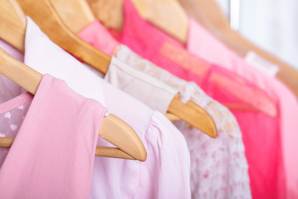 pink clothes on hangers