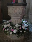 Flowers round the Font