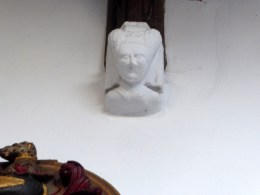 Carved head on an arch stop