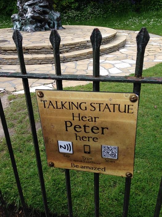 Talking statue plaque