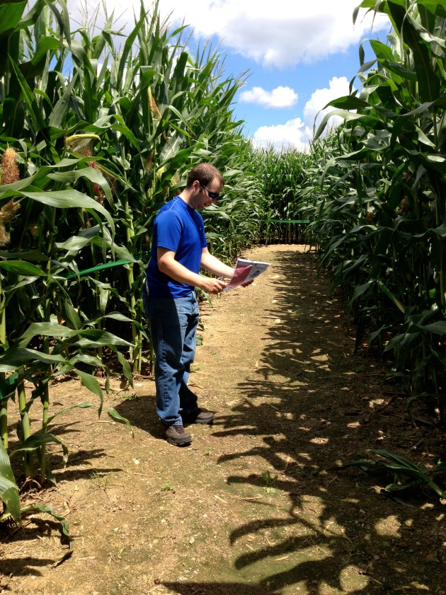 Micah contemplating corn maze directions