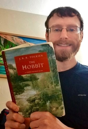 A Backpack Full of Books reading The Hobbit