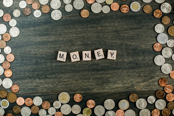 Money scrabble tiles and coins