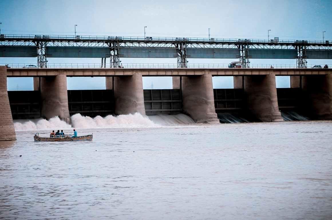 people in boat near water dam