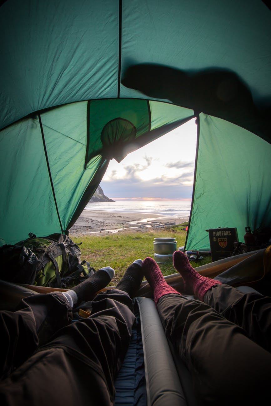 two people lying inside tent