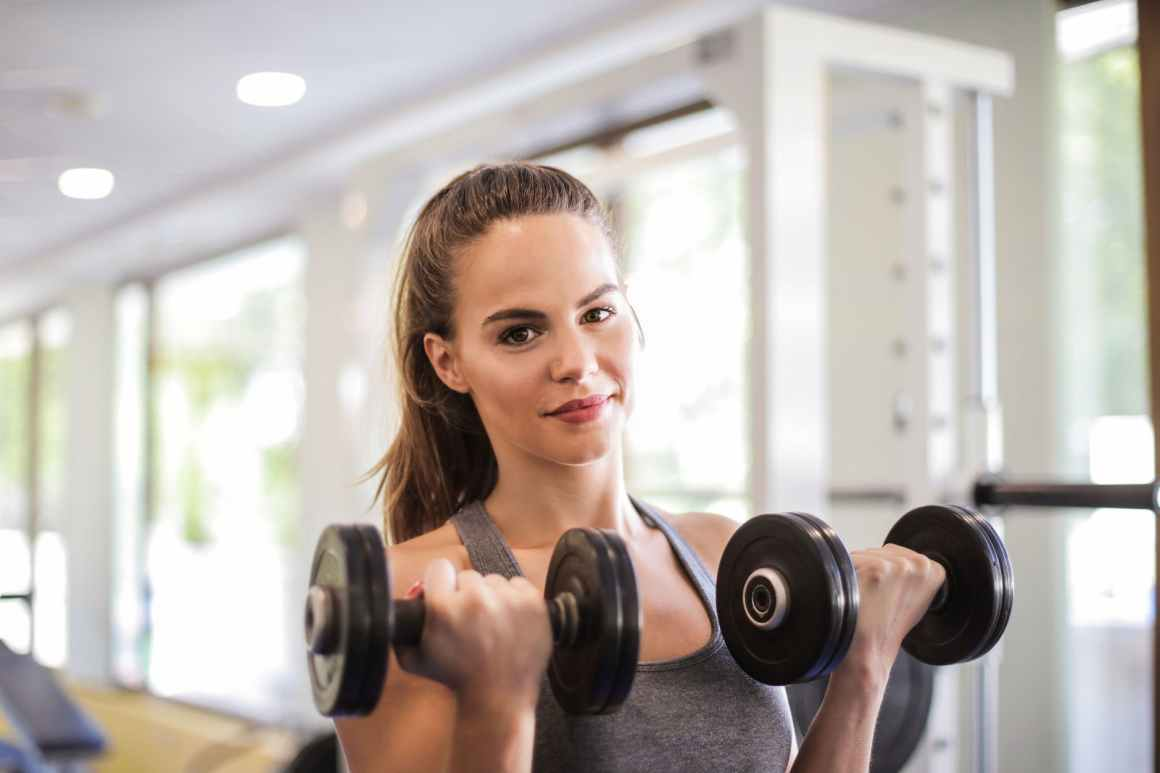 photo of woman doing bicep curls