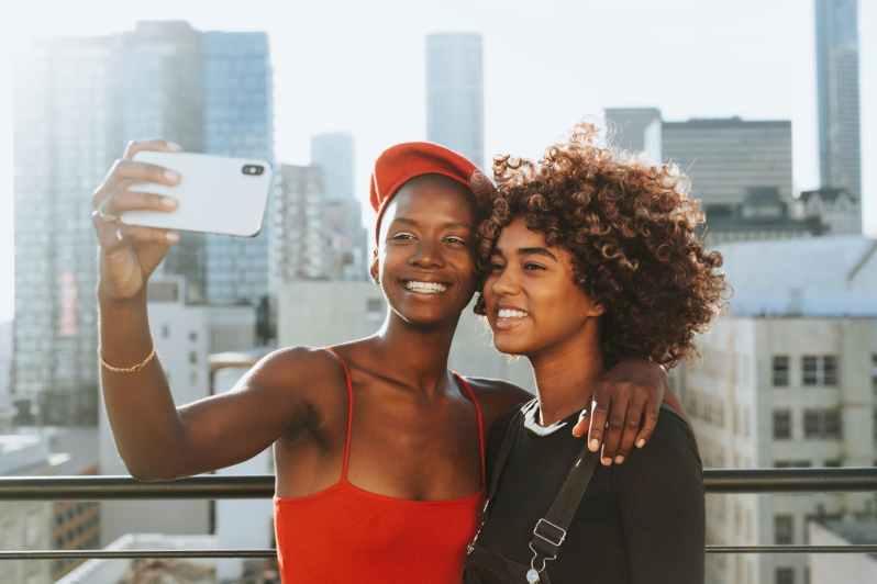 two women taking photo
