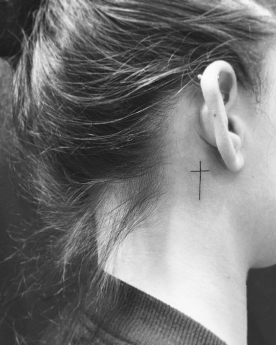 cross tattoo ear