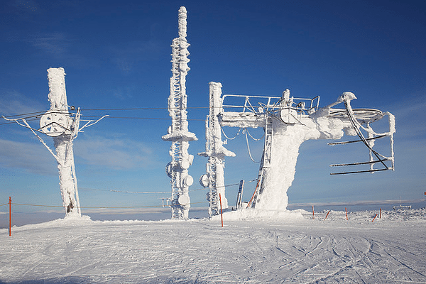 Snow covered ski lift in Norway