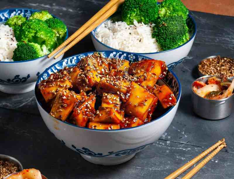 bowl of orange sesame tofu on a table