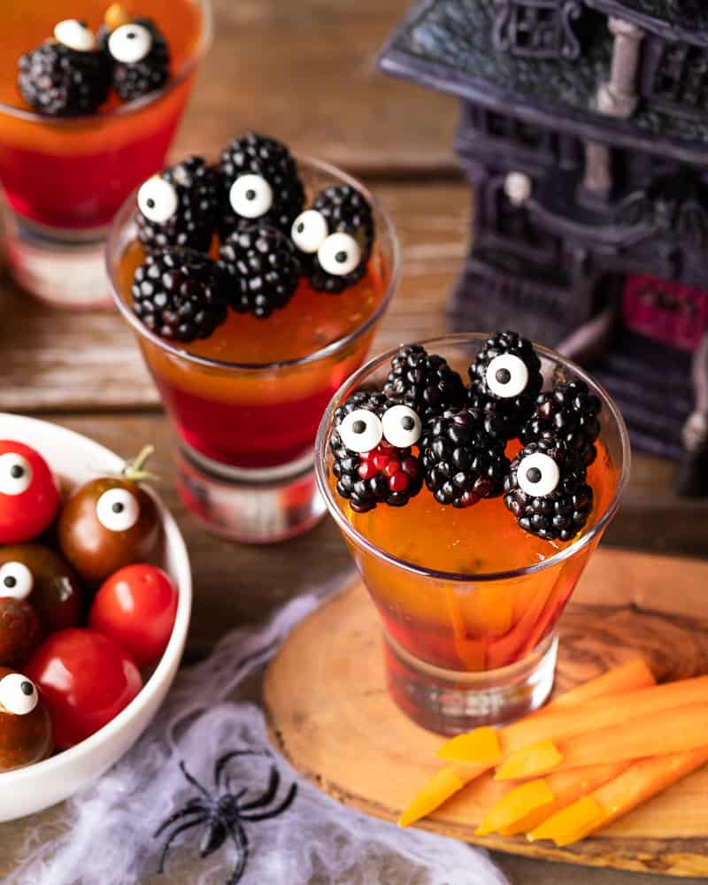 vegan jello topped with blackberry's with googly eyes