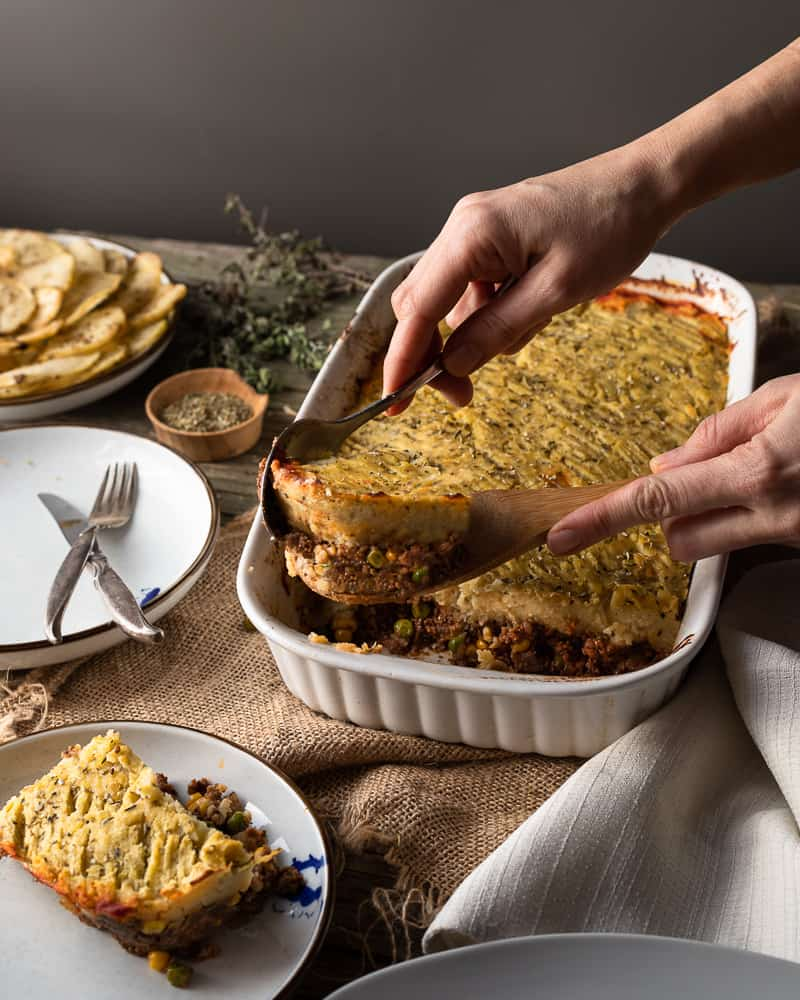 Easy shepherd pie being served on a wooden table