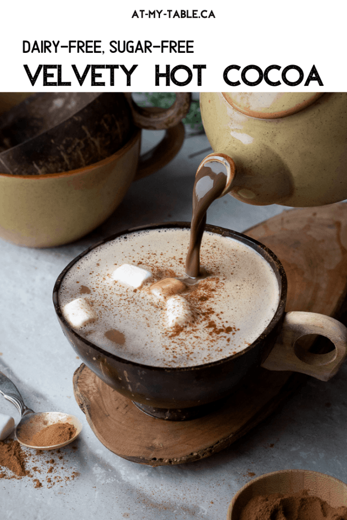 velvety hot chocolate being poured into a coconut cup