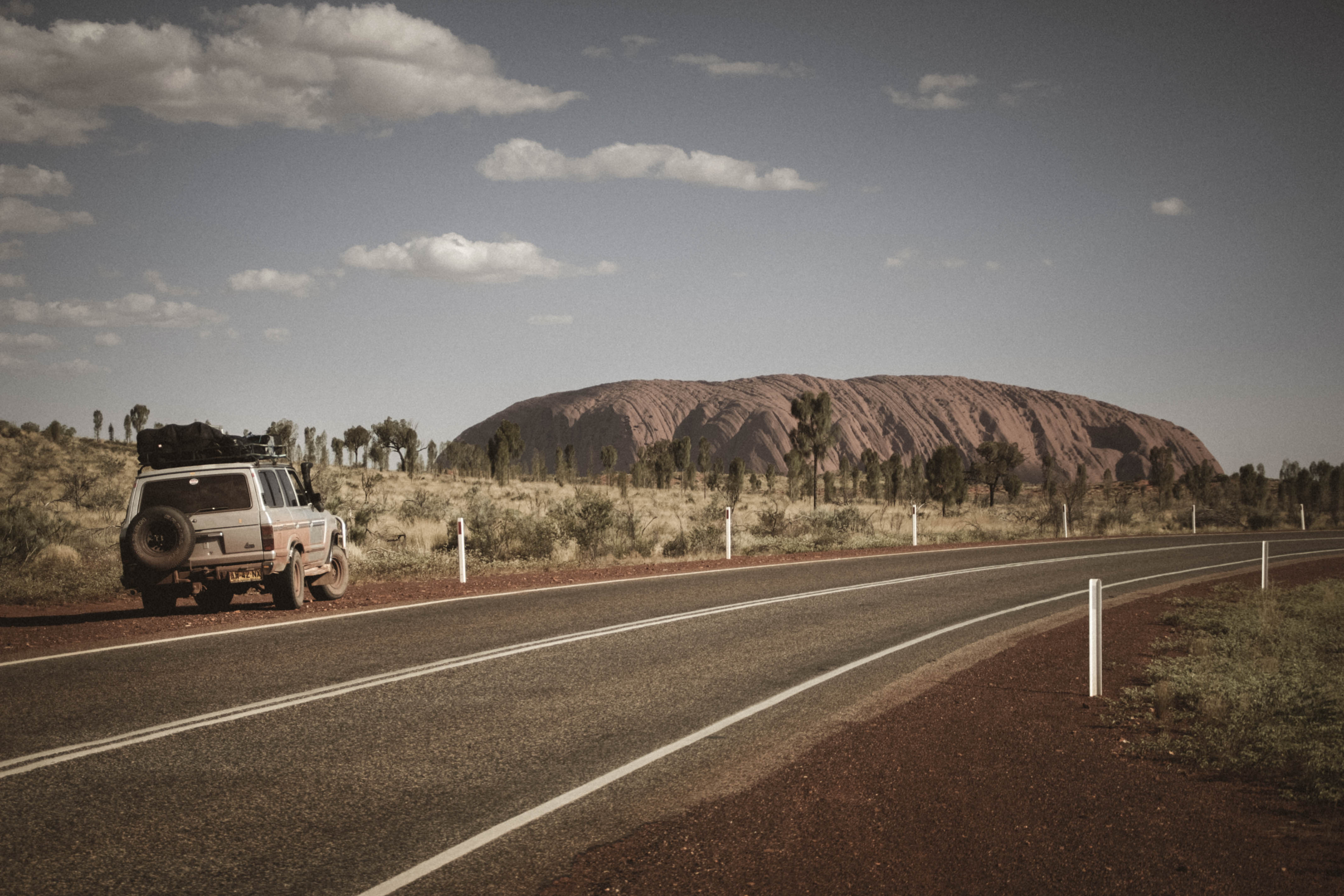 Camper car in australia on the side of a road.