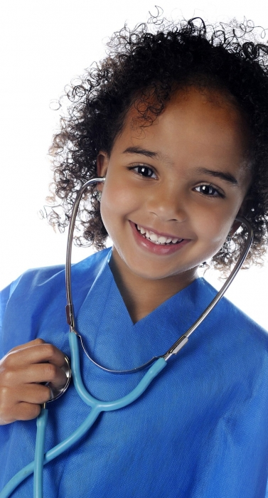 """Portrait of an adorable preschool """"docotr"""" in scrubs happily listening to her own heart through a stethoscope.  On a white background."""