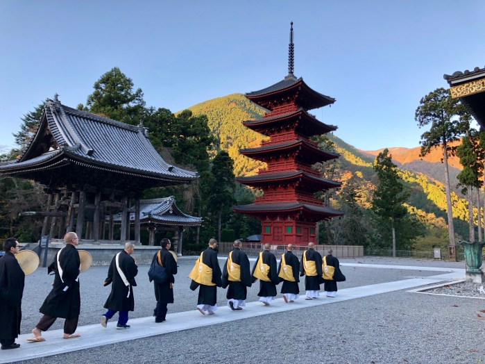 Priests in training marching and chanting in front of Minobusan Kuonji Temple