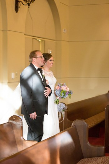 Father of the Bride enters the chapel with his daughter.