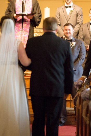 The Groom's First look at his Bride as her father gives her away.