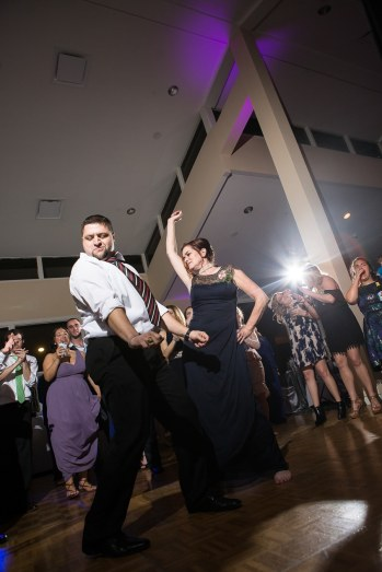 Lots of energy on the dance floor captured by the woodlands resort wedding photographer.