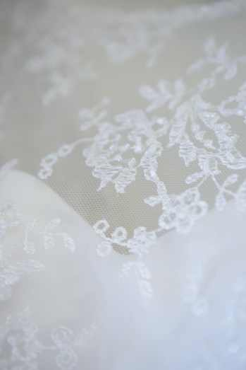 Delicate lace detail on the brides gown.
