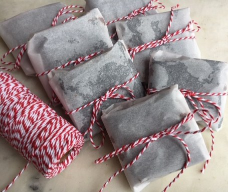 Brownies, wrapped in paper and tied with string.